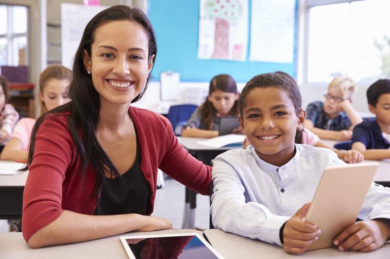 Latina teacher with student