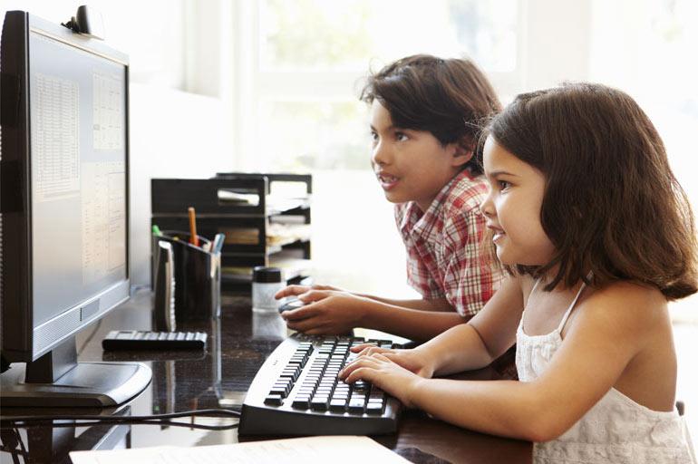 grade school children using a computer